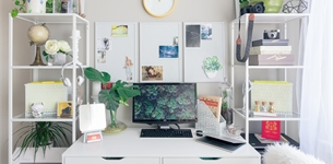 Working from home desk with computer and plants